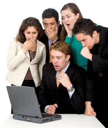 people looking at computer surprised